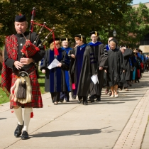 Faculty in robes marching