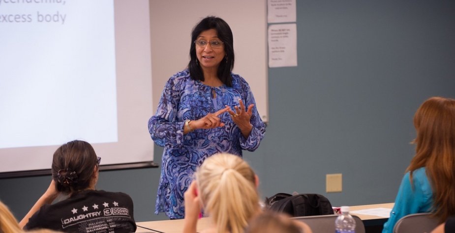 Professor lecturing to students in classroom