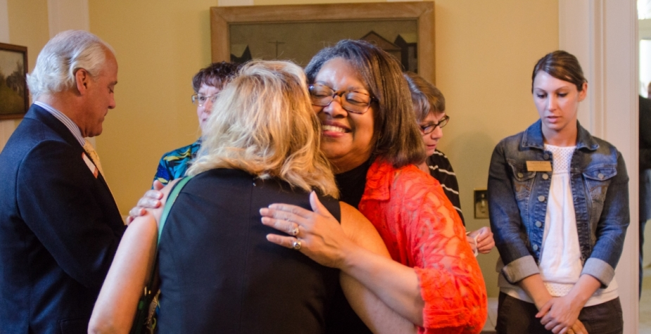 President Conway-Turner embraces a donor.